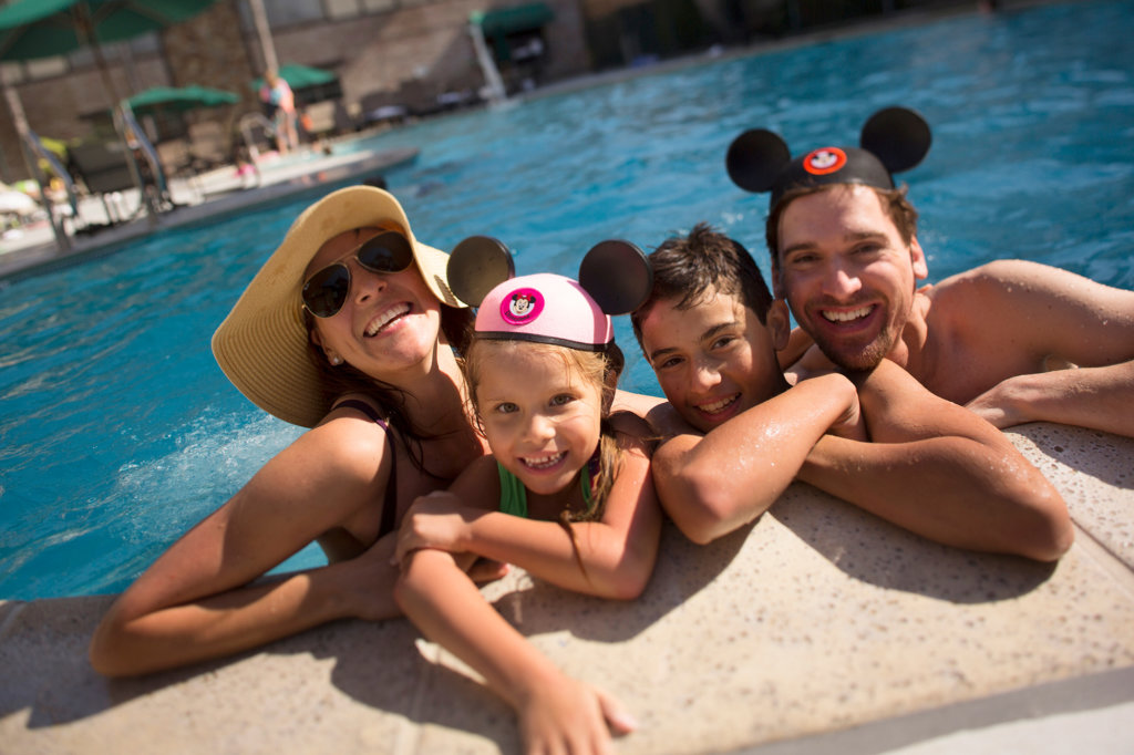 Family enjoys heated pool at a Disneyland Good Neighbor Hotel in California
